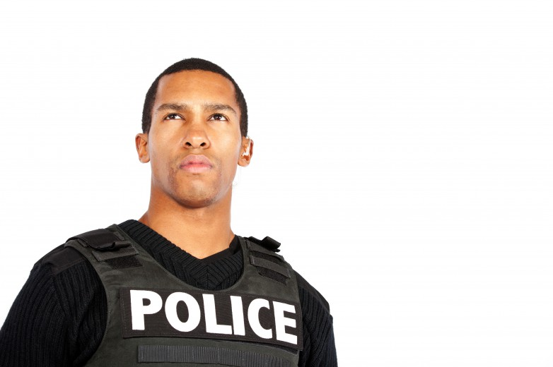 young black police officer looking upward; white background
